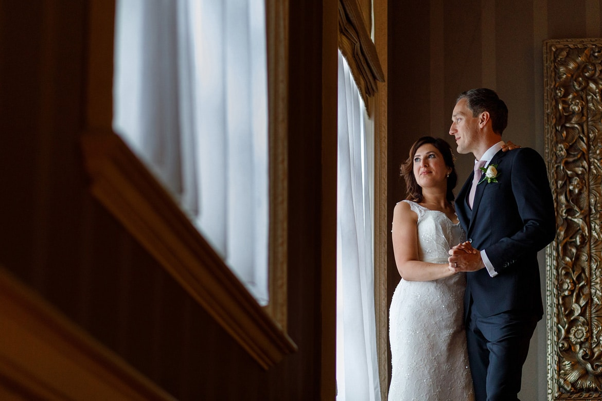 a window portrait at a hedsor house wedding