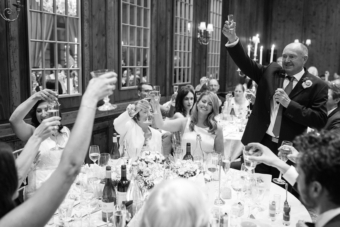 the father of the bride raises a toast