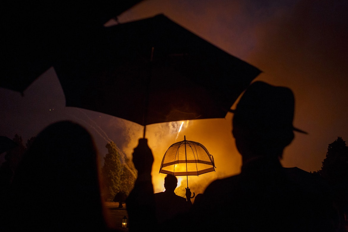 umbrellas during a hedsor house firework display