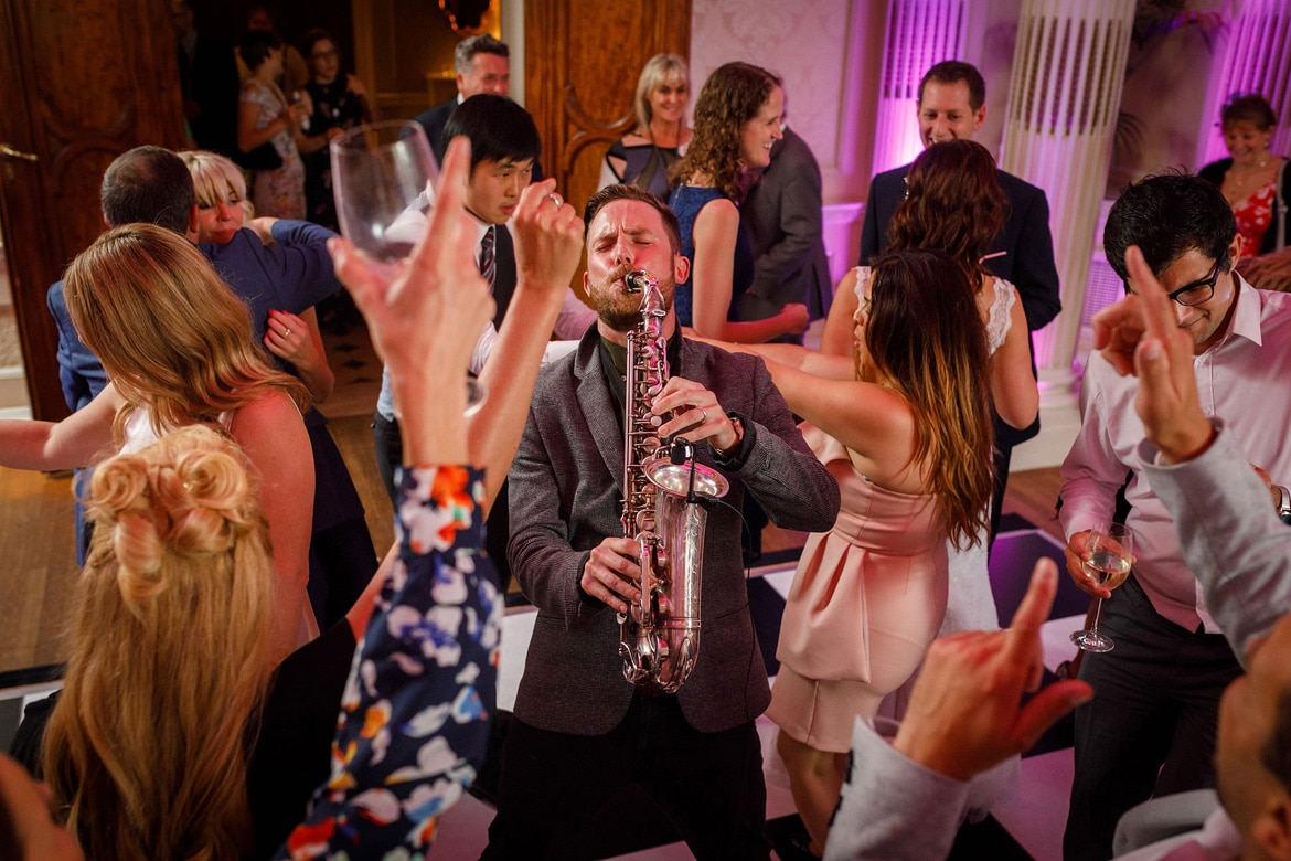 a saxophone player on the dancefloor