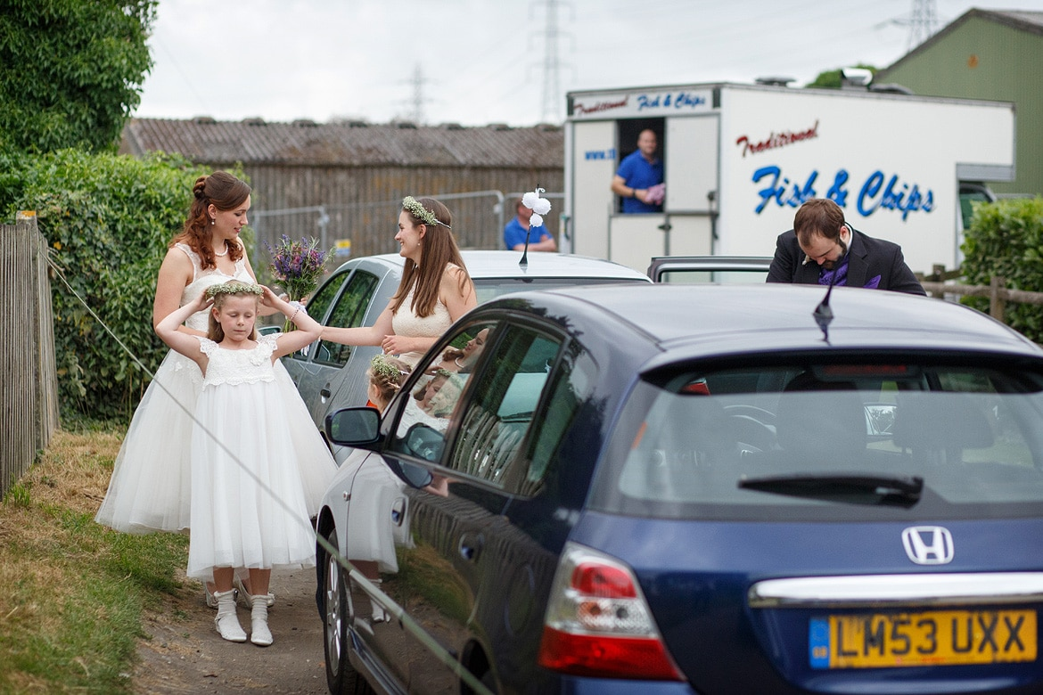 the bride and her family arrive at the church
