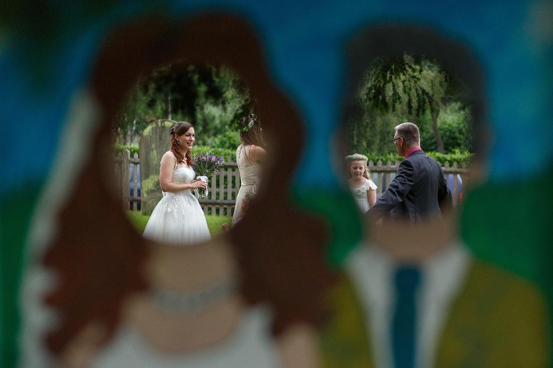 the bride seen through the comedy backdrop