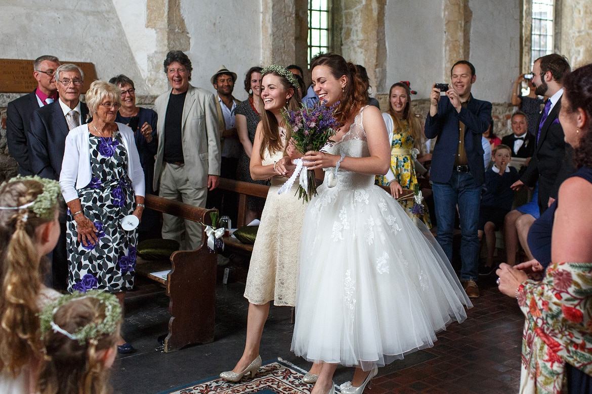 laura and her sister walk down the aisle