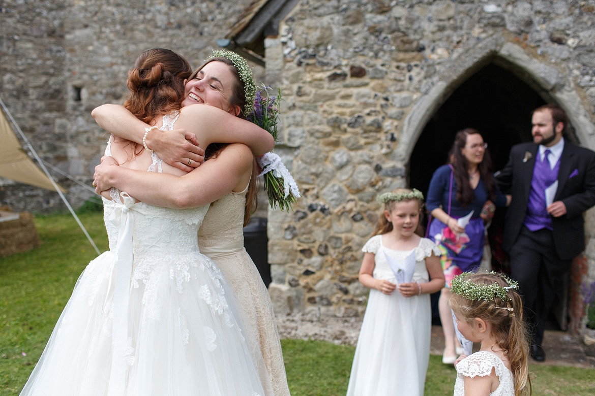 the bride hugs her sister