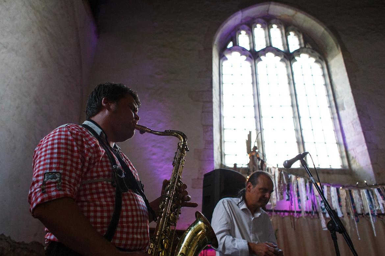 a saxophone player in lederhosen