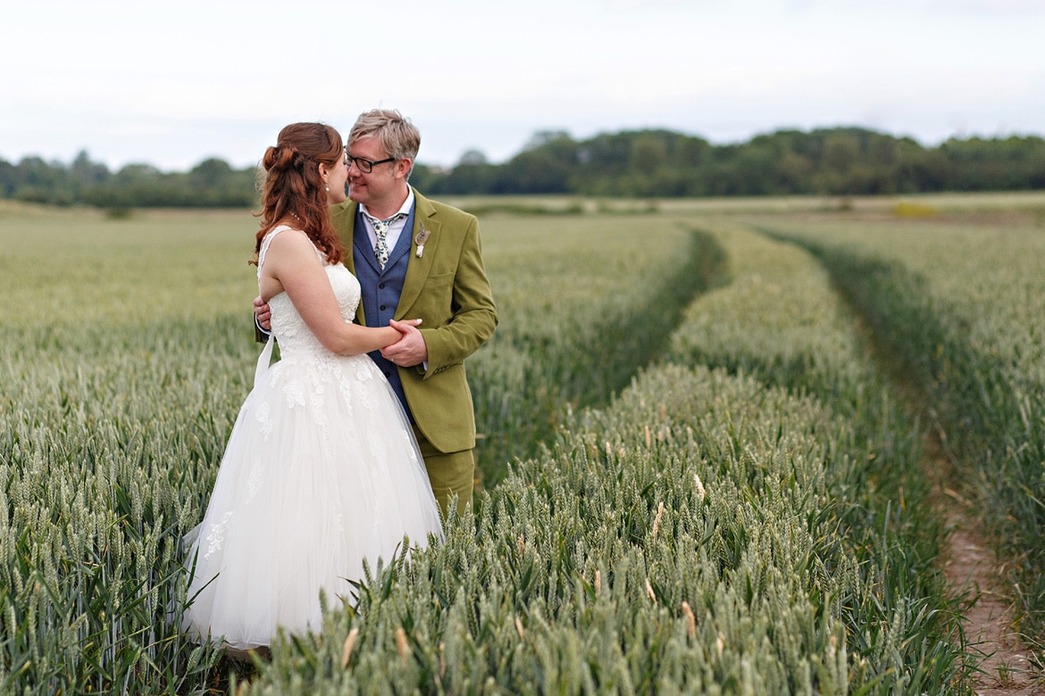 bride and groom in the cornfield