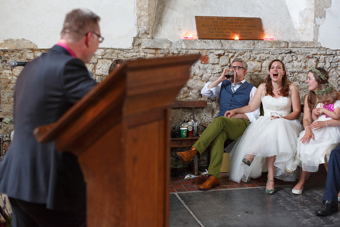 bride and groom laugh at the best man