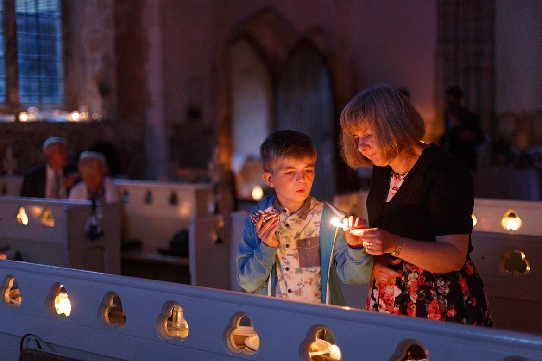 lighting candles as evening falls