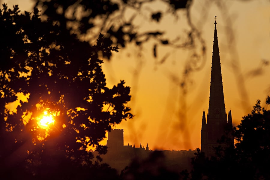 both norwich cathedrals at sunset