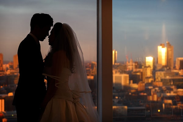 bride and groom silhouette in front of a london skyline