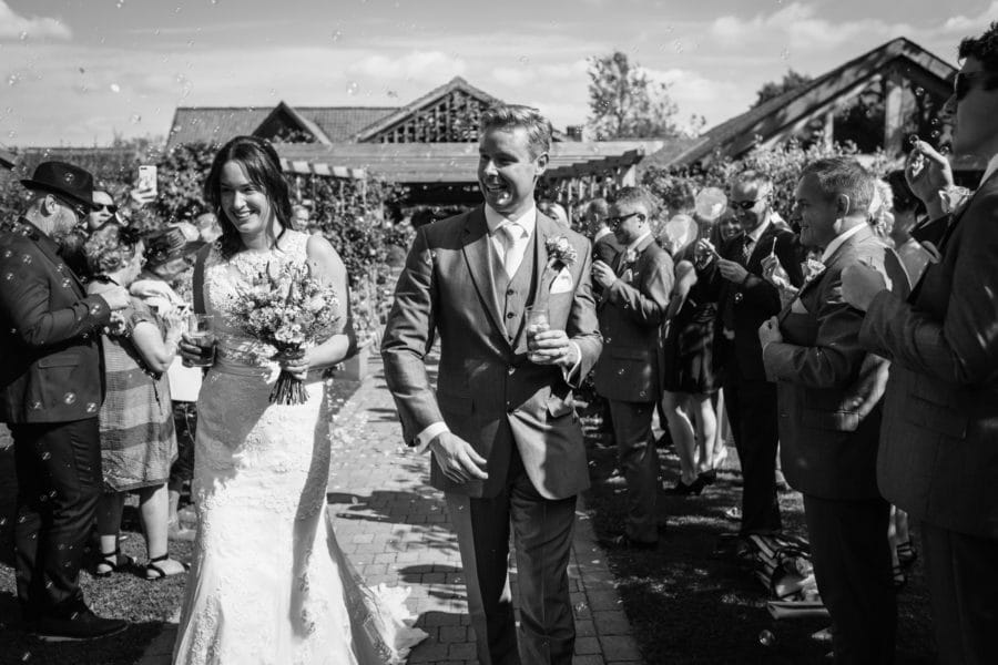 walking through the bubbles at a maidens barn wedding