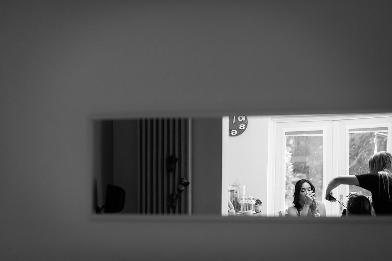 the bride in a long mirror