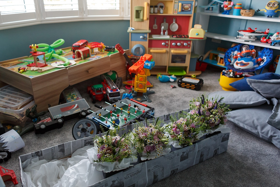 the girls flowers stored in the play room with toys all around