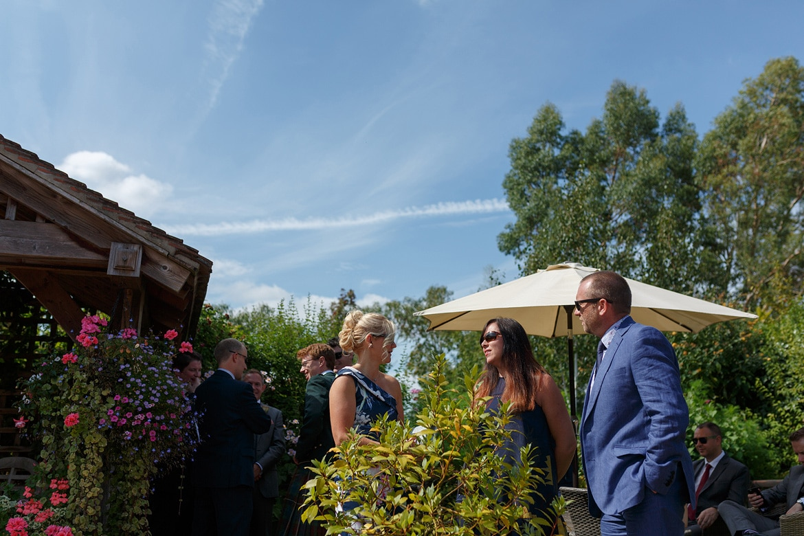guests chat in the sunshine before the ceremony