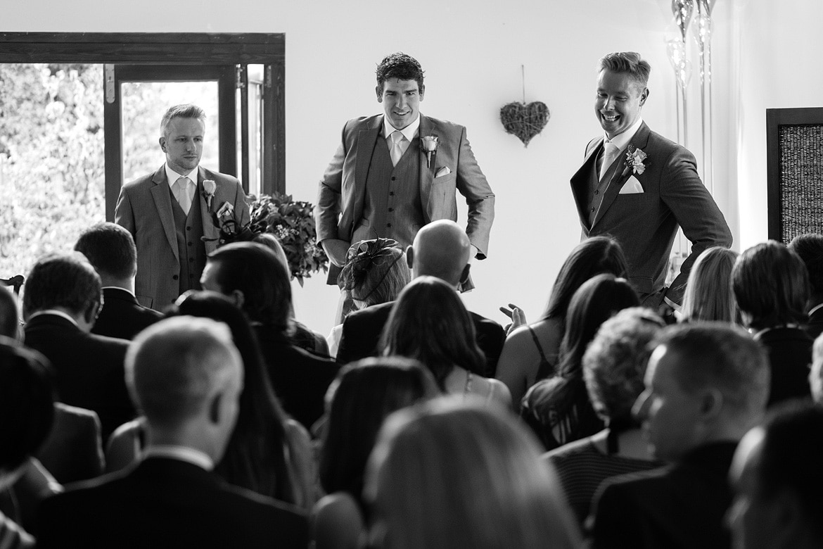the groom and his best men speak to the guests