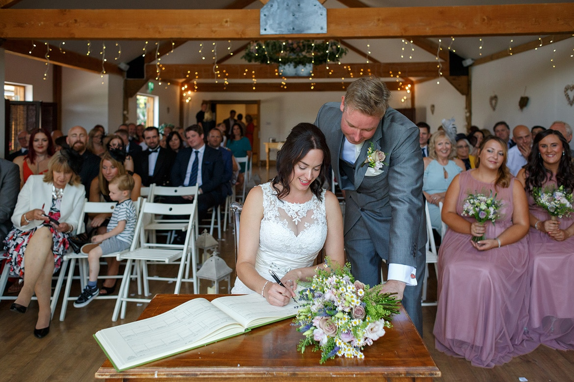 signing the register at maidens barn in essex
