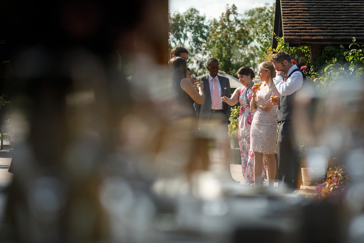 the wedding guests enjoying the august sunshine