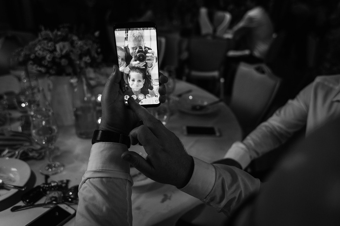 the wedding photographer caught in a guests phone