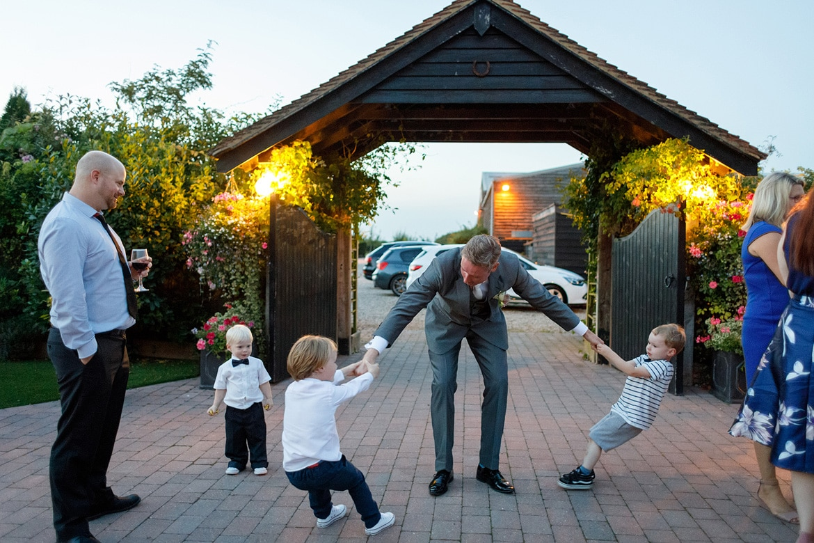 the groom is pulled by two children
