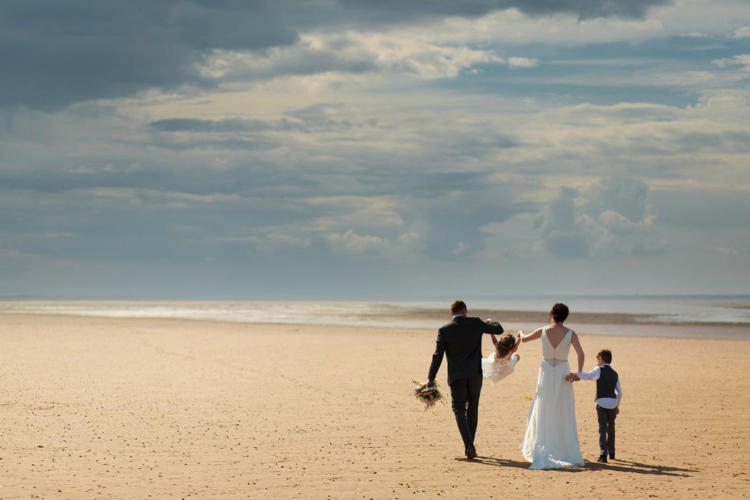 wedding couple on a north norfolk beach