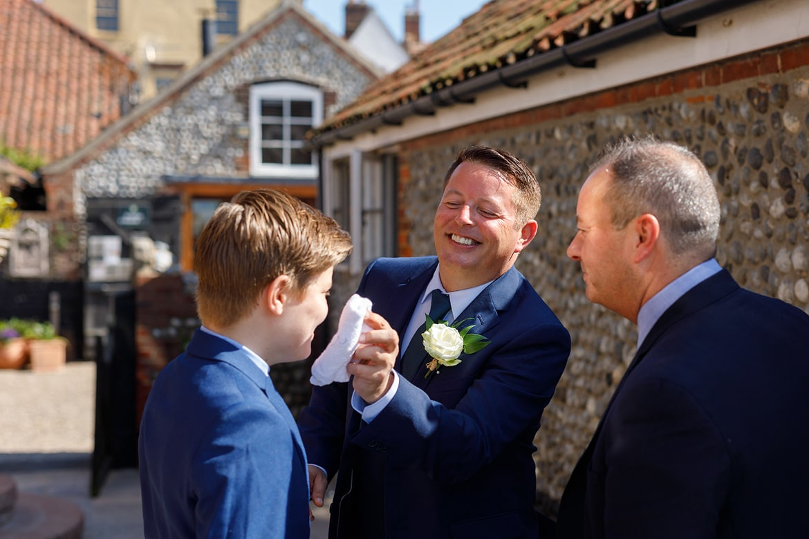 the groom helps his son cool off