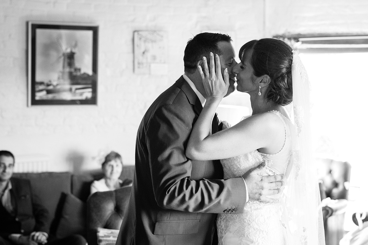 first kiss at a cley mill wedding