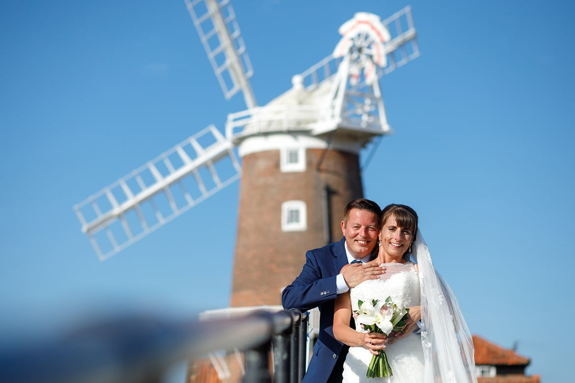 bride and groom in front of cley windmill
