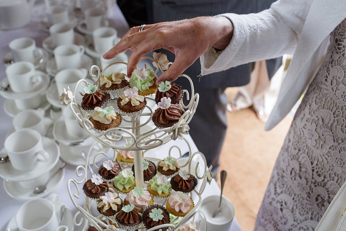 guests enjoy cupcakes before the wedding