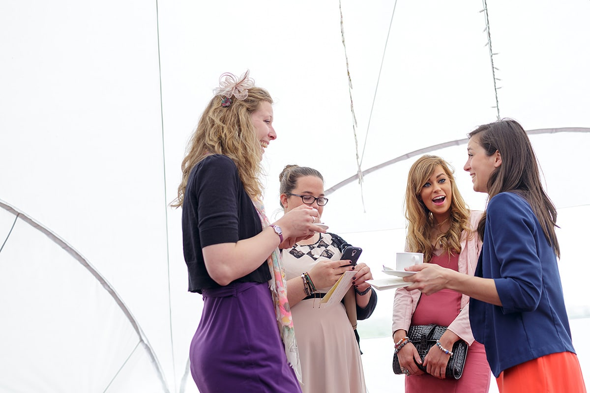 guests laugh in the bell tent at godwick barn