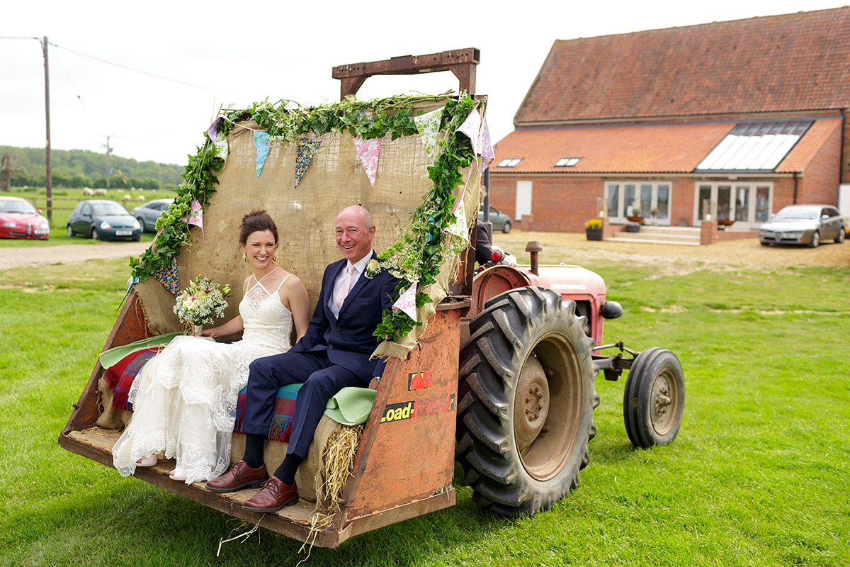 the bride and her father arrive in the godwick tractor