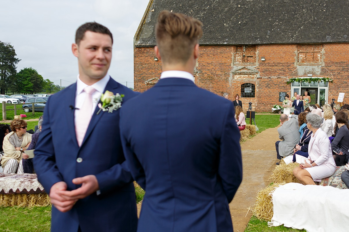 the groom looks at his best man