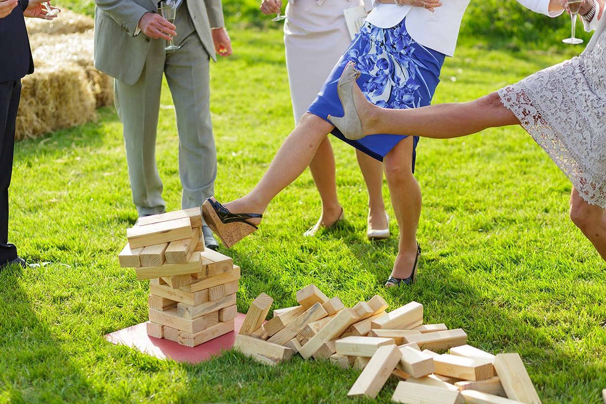 a guest kicks over the jenga pile outside godwick barn