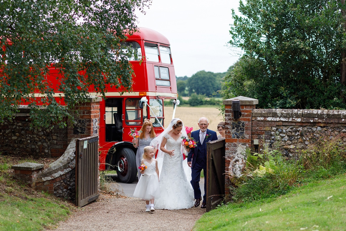 the brides father steps on her dress in front of the routemaster bus