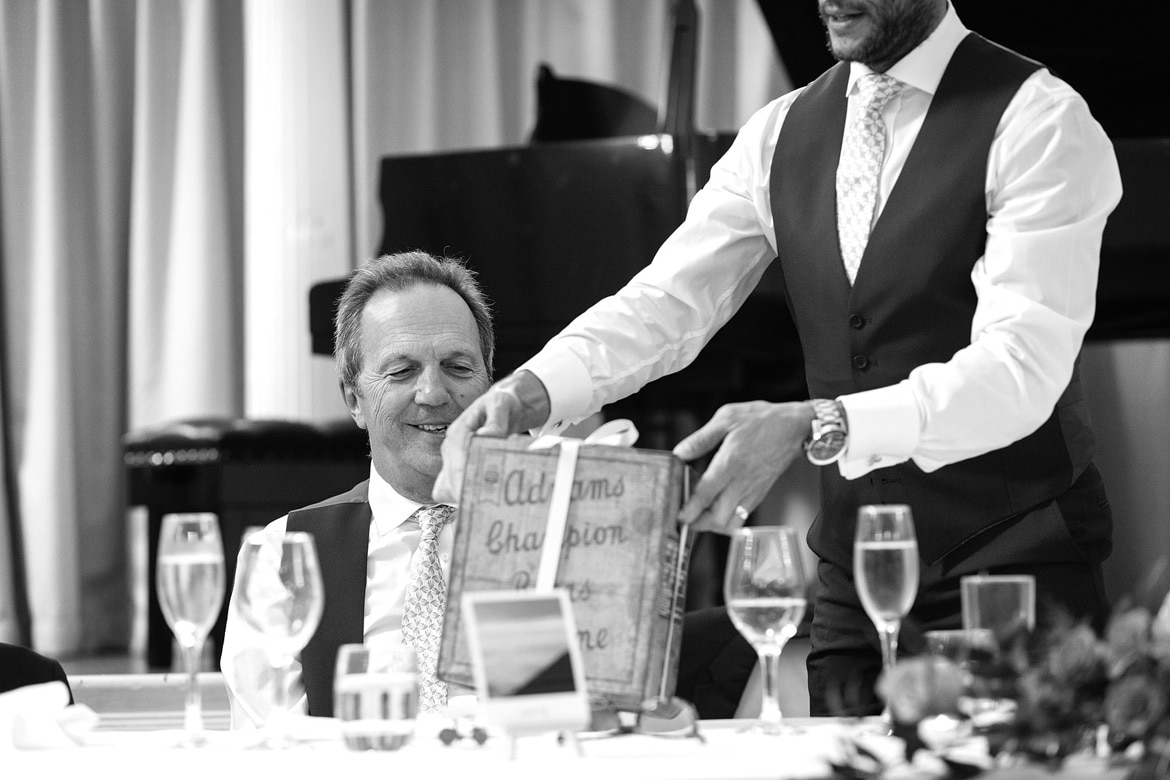 the groom presents his dad with a present
