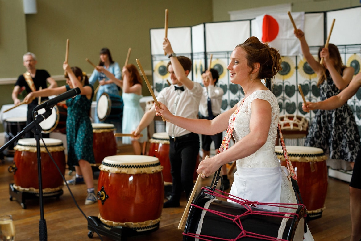 the bride leads the taiko drumming