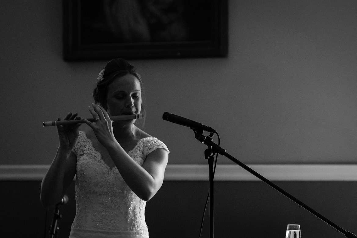 kate plays a wooden flute during her assembly house wedding