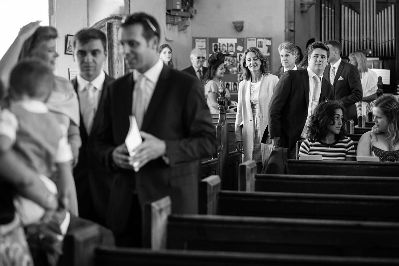 guests arrive at an old buckenham church wedding