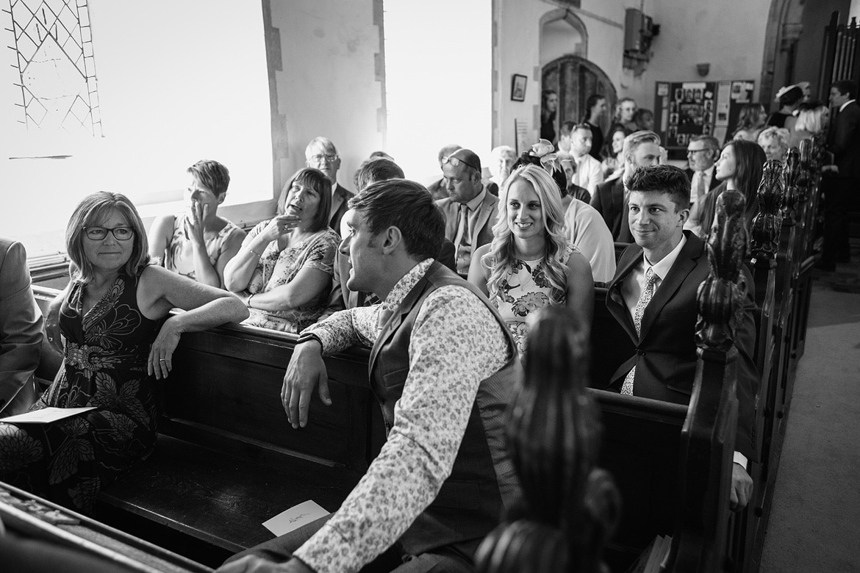 guests at a wedding at old buckenham church