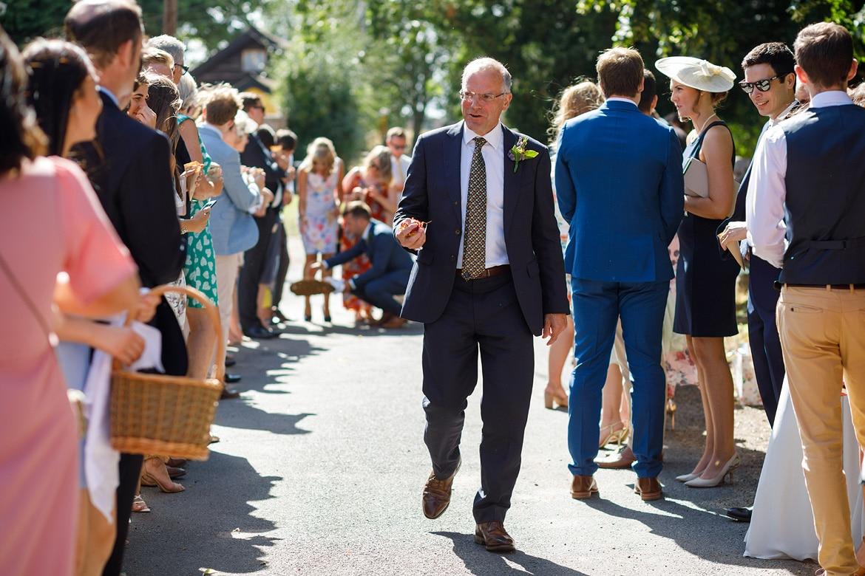 the brides father with confetti