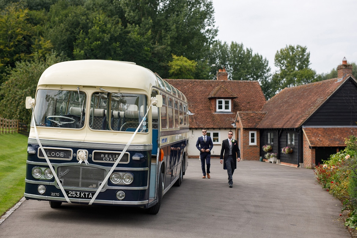 with the vintage wedding bus outside the brides home