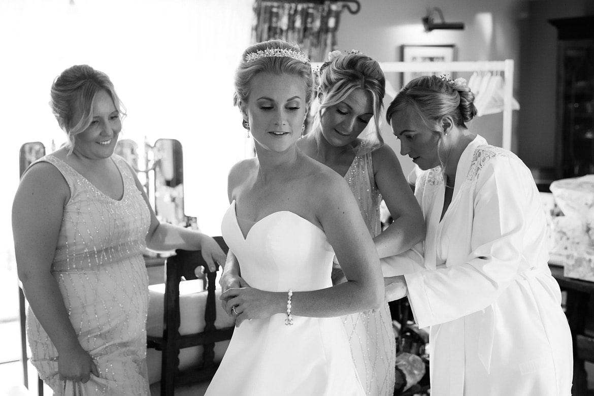the bride gets into her dress