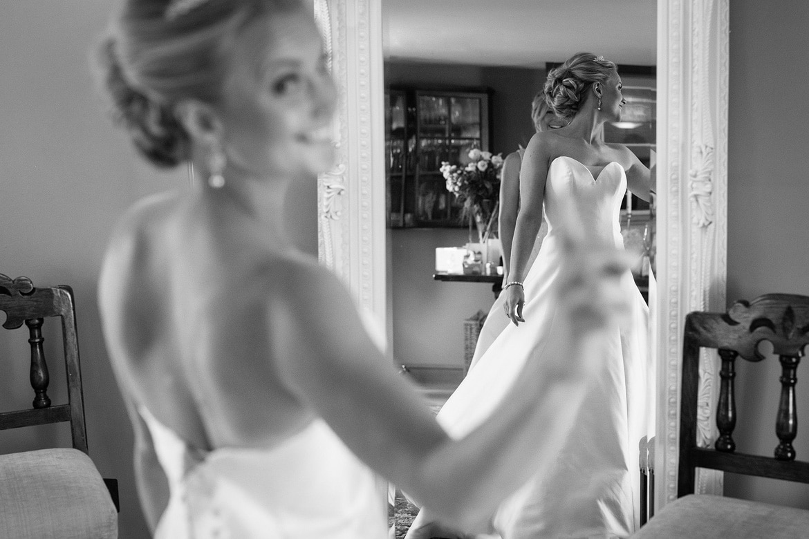 the brides reflection in a mirror