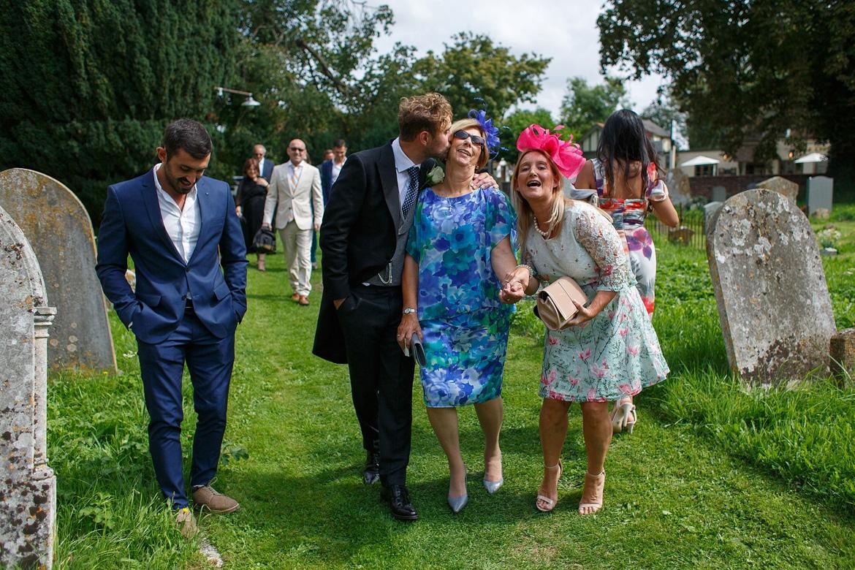 the groom walks into the church
