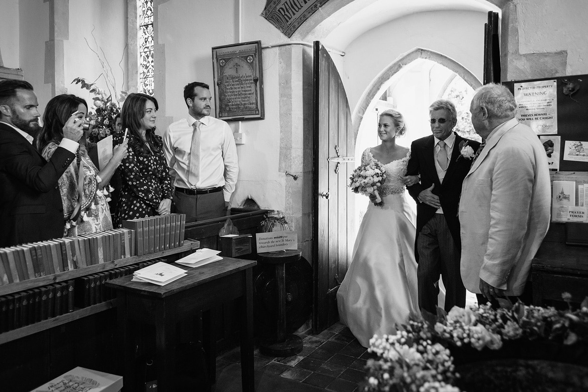 bride and father enter the church