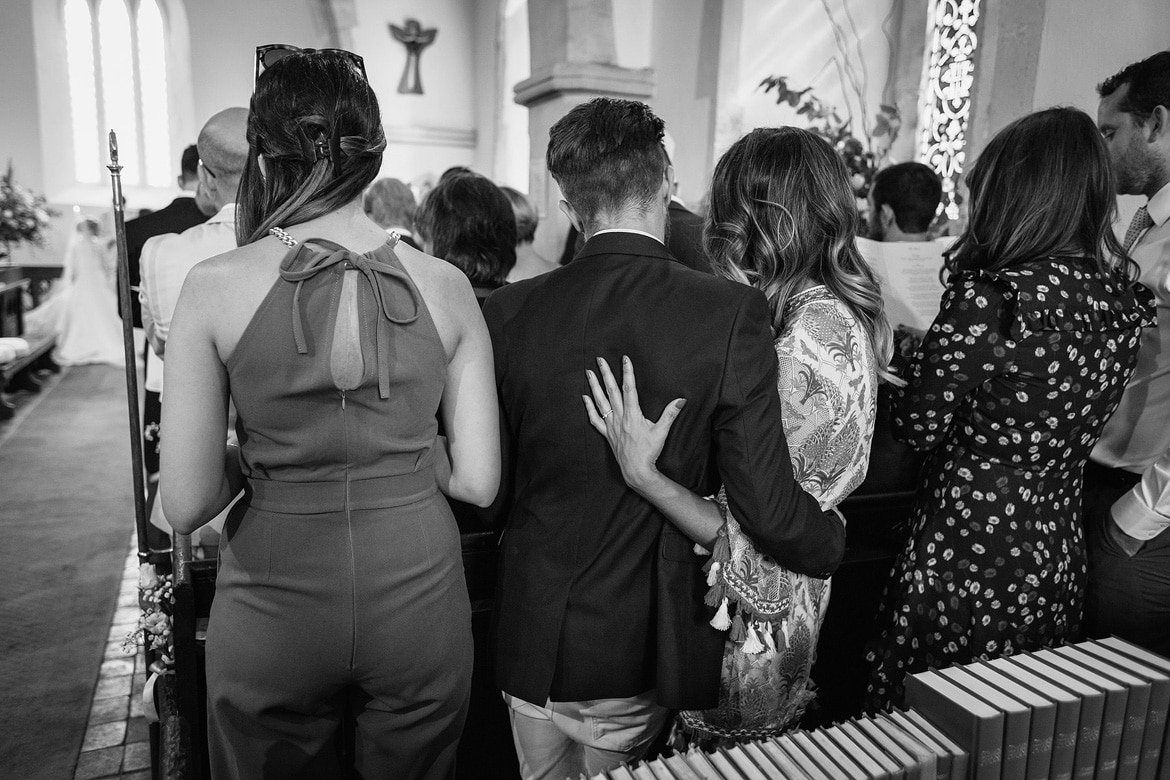 guests hug during the wedding ceremony