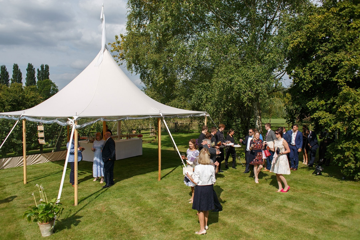 guests arrive for a summer marquee wedding