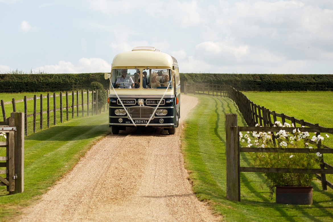 the vintage wedding bus arrives on site