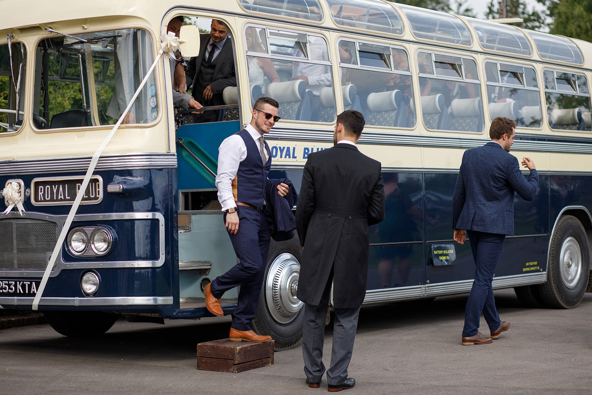 guests leaving the vintage wedding bus