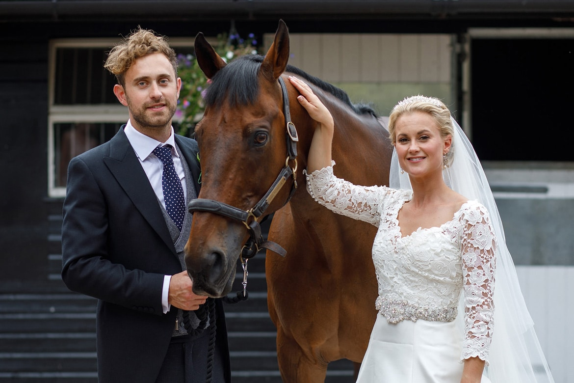 bride and groom with the horse