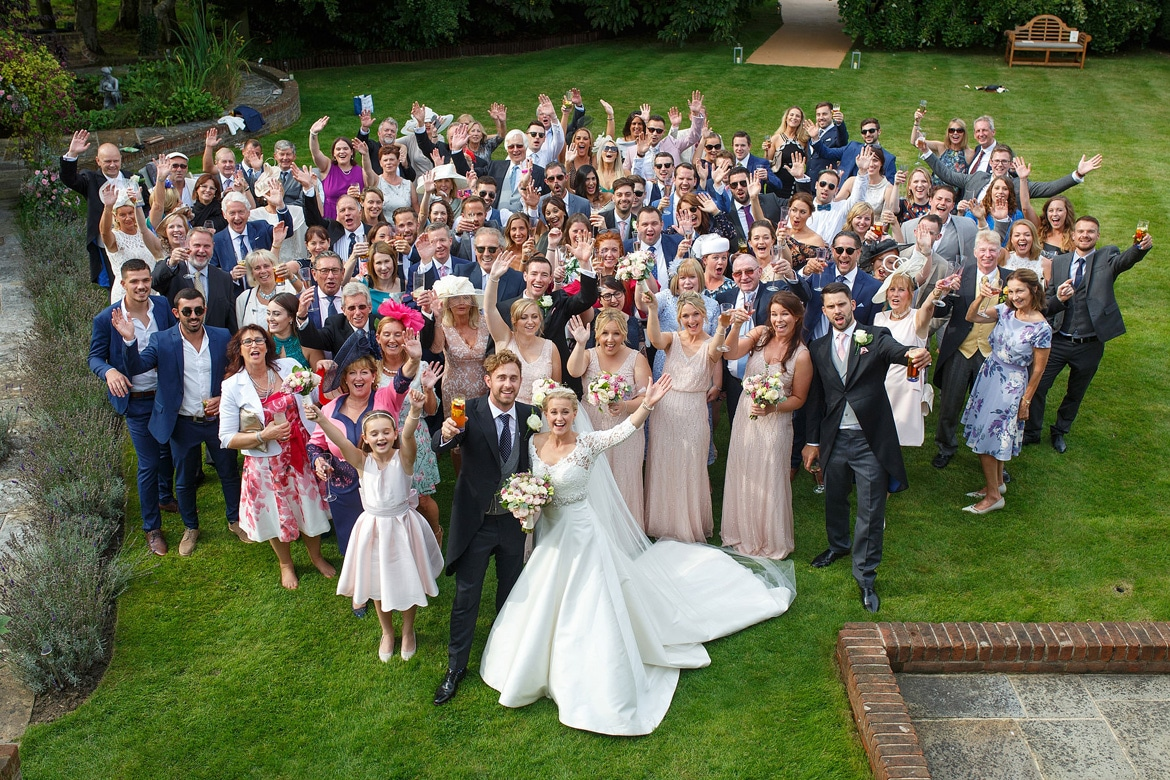 a group photo of everyone at the wedding